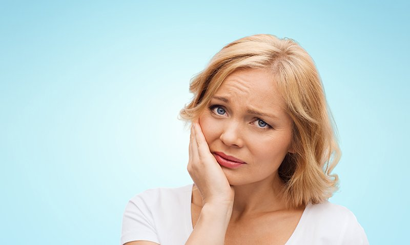 woman with toothache needs emergency dental care